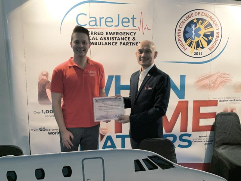 CareJet President & CEO Anthony Decoste receiving a Certificate of Appreciation from PCEM President Dr. Martin Luna